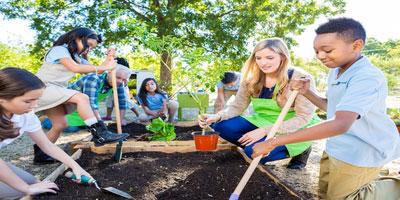 teacher and students gardening