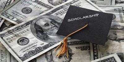 graduation cap that says scholarship