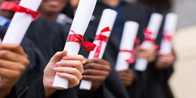 people holding diplomas