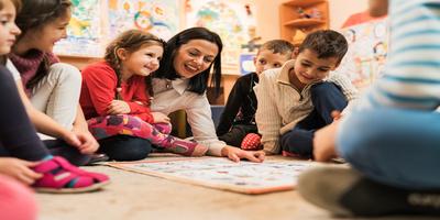 preschool teacher teaching young students