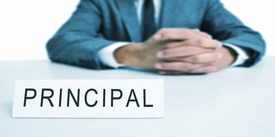 principal sitting at a desk