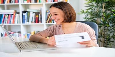 woman at computer typing resume