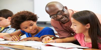 male teacher mentoring students