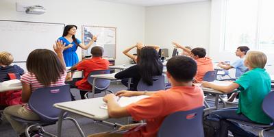 teacher in front of classroom