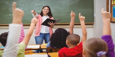 teacher standing in front of room