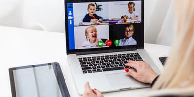 Woman video conferencing with children