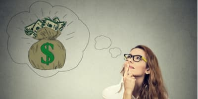 Woman thinking of a bag of money